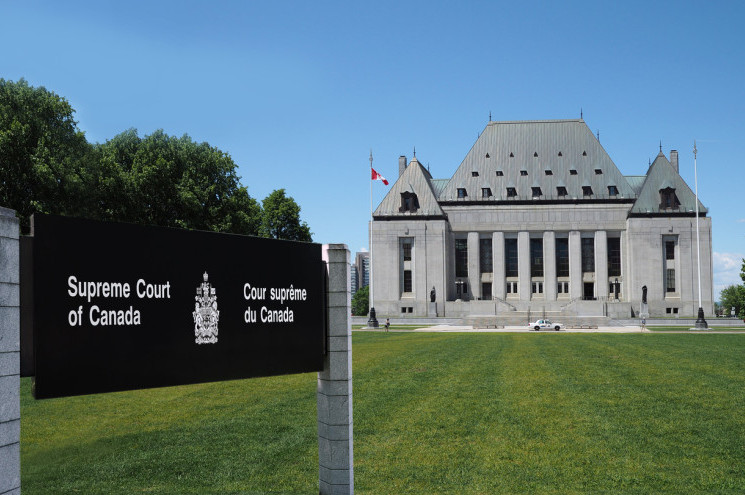 Supreme Court of Canada building with its lawn sign